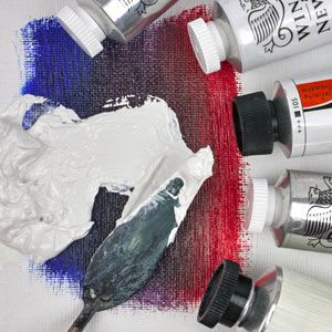 Tubes of white oil paint and palette knife