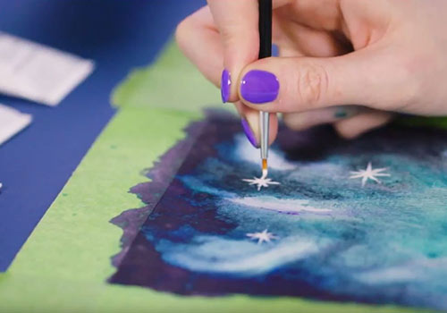Use white gouache to paint on some stars