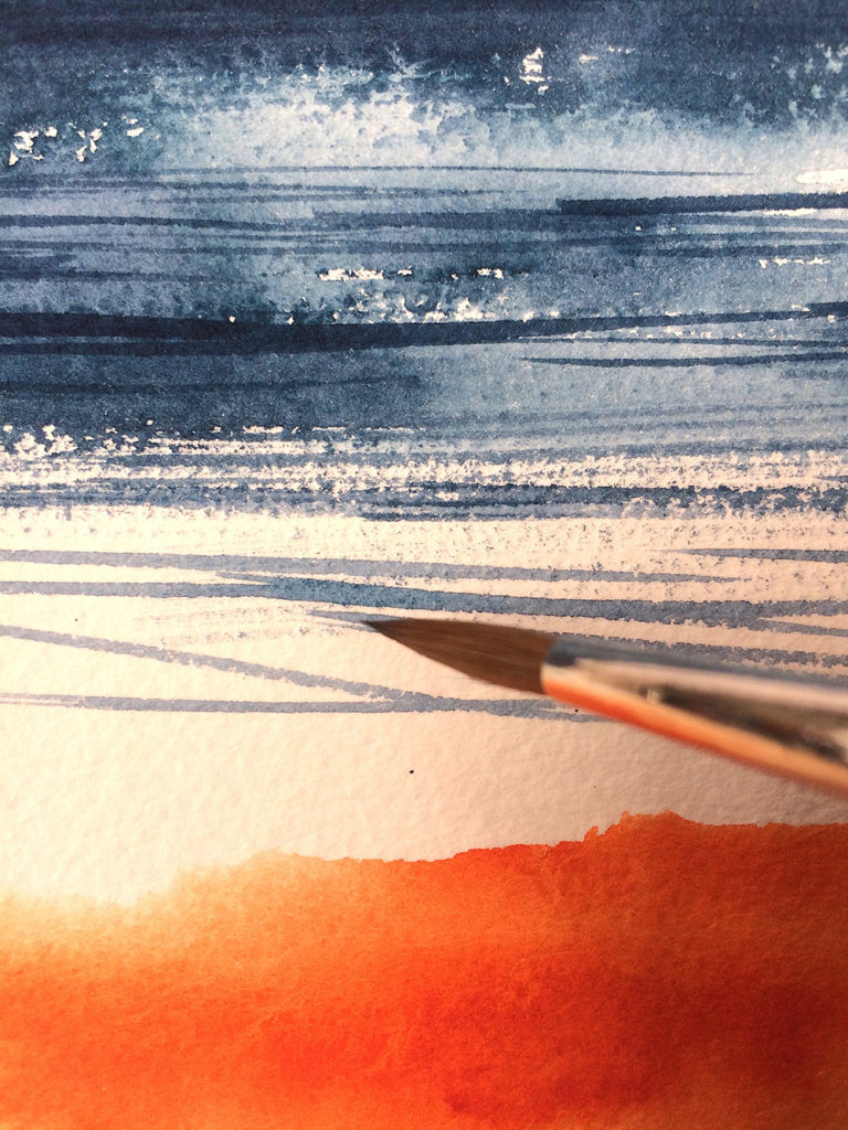 Using the point of the brush, to add a few crisp lined marks to the sea