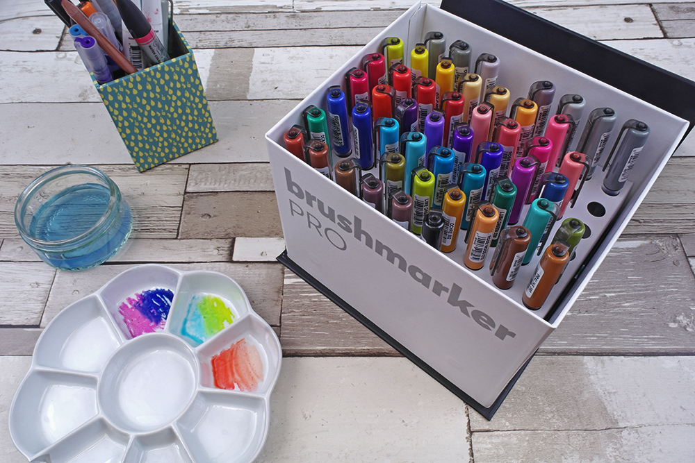 Karin Brushmarker PRO pens stored vertically in storage box