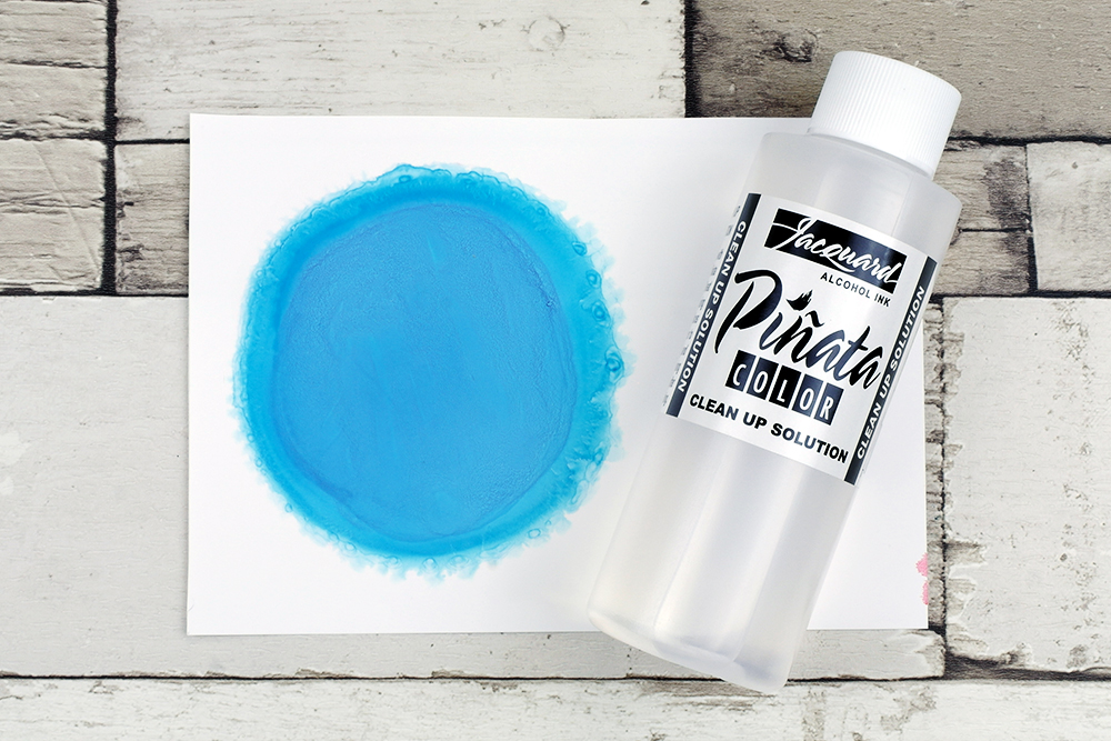 Piñata Alcohol Ink Baja Blue diluted with Piñata Alcohol Ink Clean Up Solution