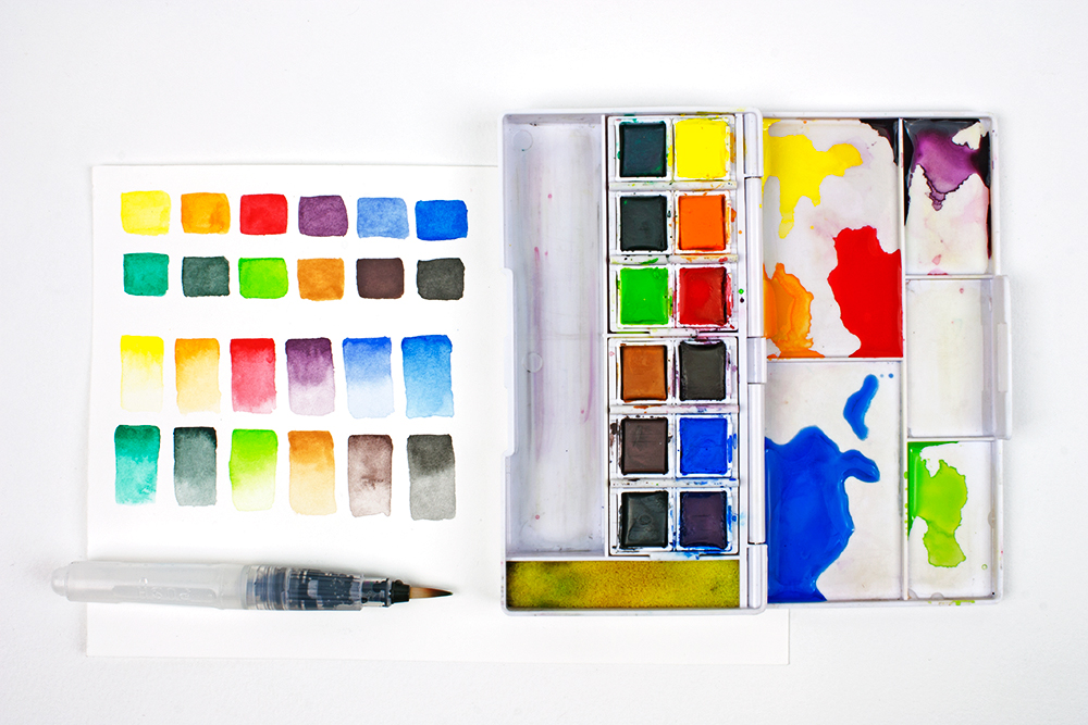 12 colour swatches from the Derwent Inktense Paint Pan Travel Set