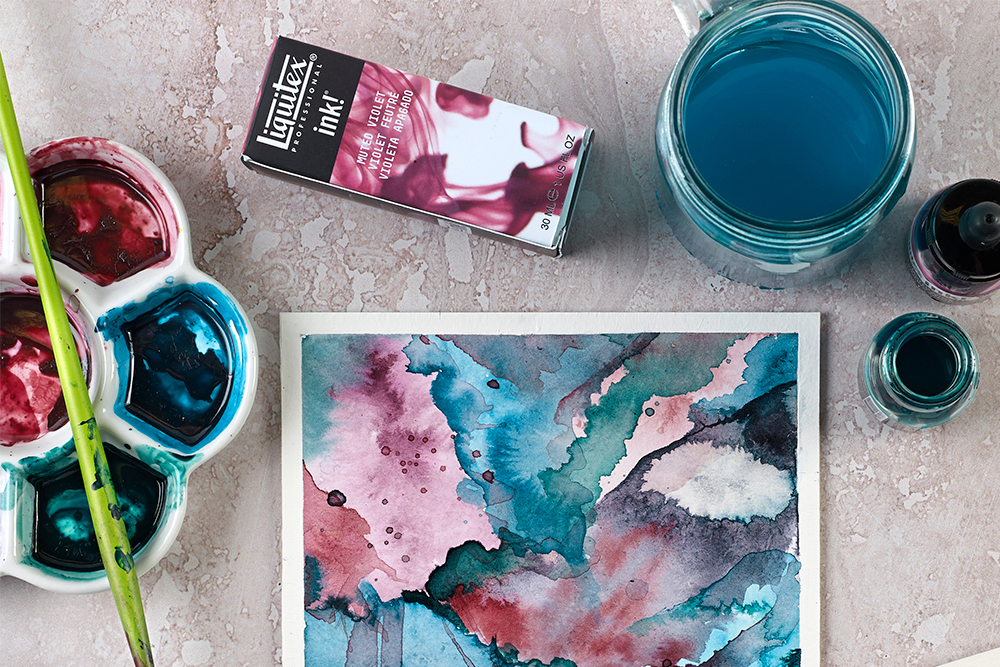 A palette with deep wells being used with acrylic inks