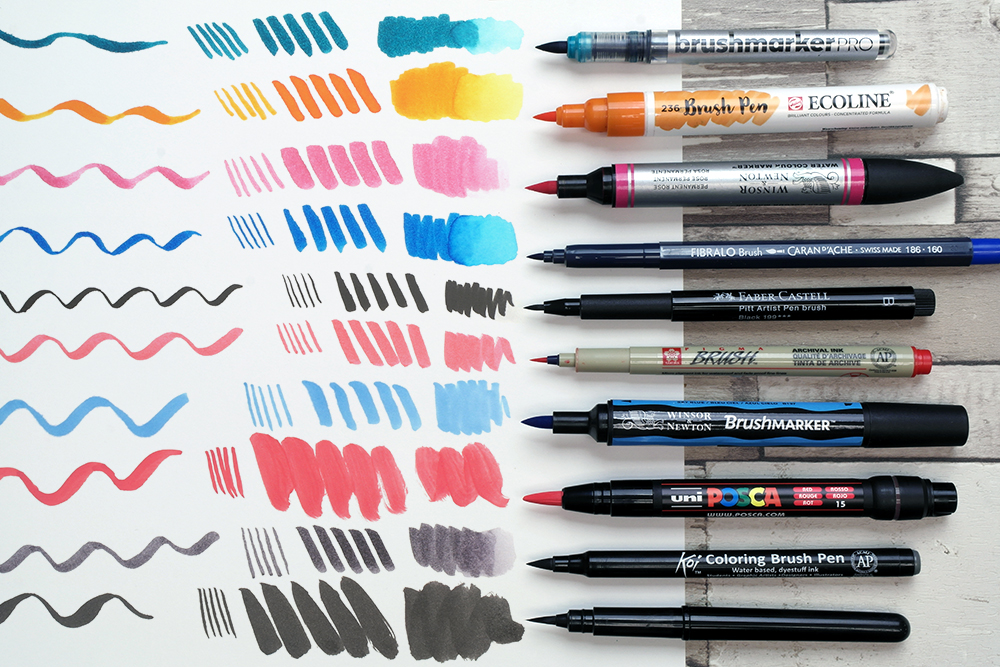 A selection of artists brush pens with  swatches of each pen.