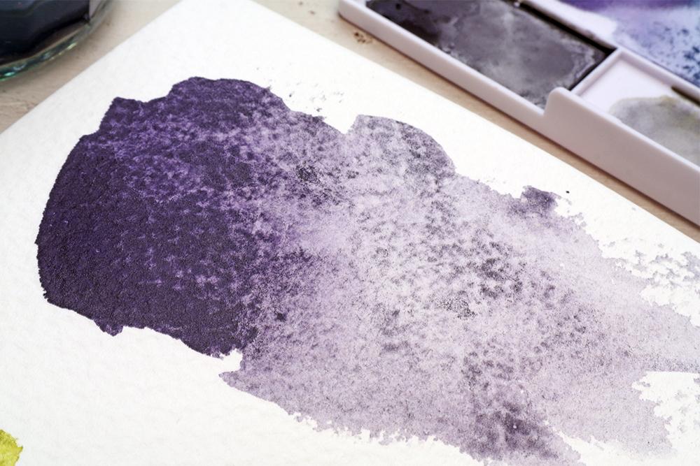 Derwent Graphitint Aubergine Paint Pan Swatch on Rough Watercolour Paper
