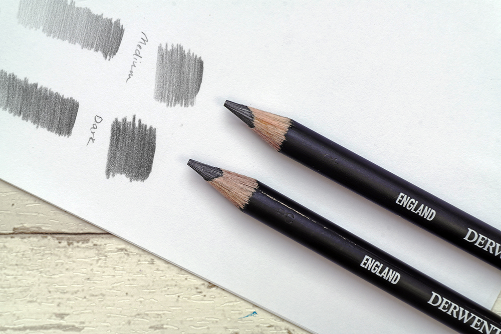 The full range of Derwent Onyx Graphite drawing and sketching pencils with swatches
