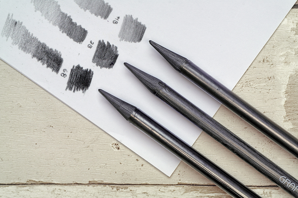 The full range of Caran d'Ache Grafstone Graphite drawing and sketching pencils with swatches
