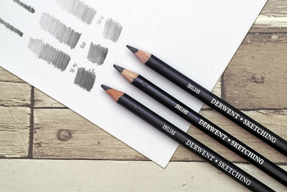 The full range of Derwent Sketching Graphite drawing pencils with swatches