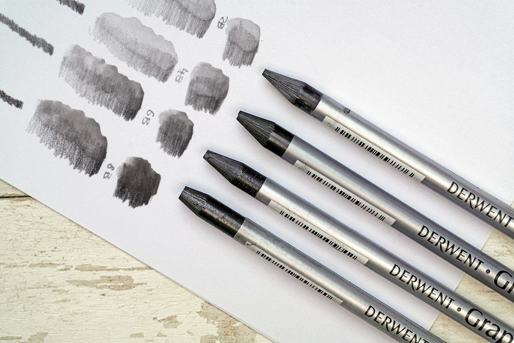 The full range of Derwent Graphitone Water Soluble Graphite drawing and sketching pencils with swatches