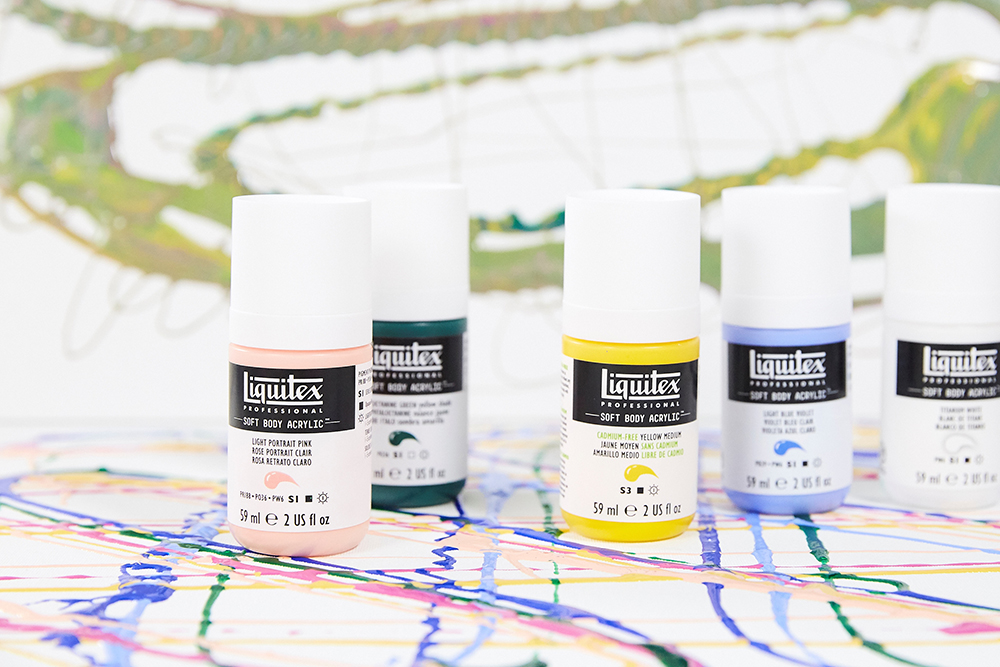A selection of Liquitex Professional Soft Body Acrylics used with acrylic pour paintings