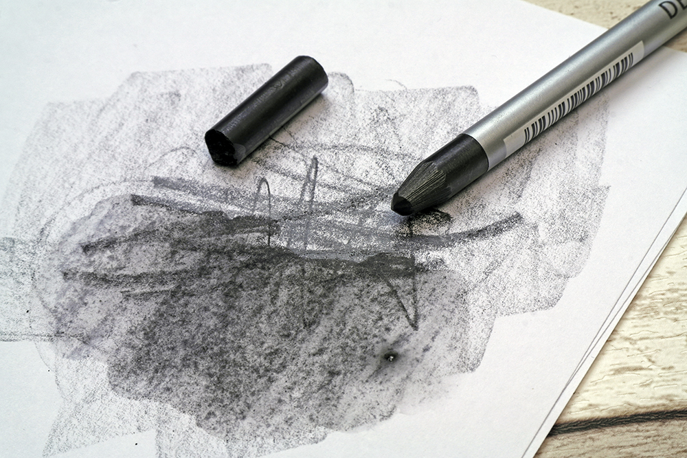 A 6B Dark Wash Derwent Graphitone stick split into chunks and used with water