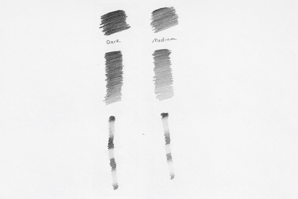 Swatches of Derwent Onyx Graphite drawing and sketching pencils in Dark and Medium
