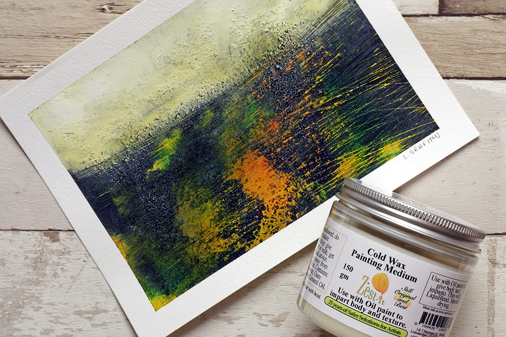 A cold wax painting using oil and cold wax medium by Liz Griffiths on a pale wooden background with a jar of cold wax painting medium