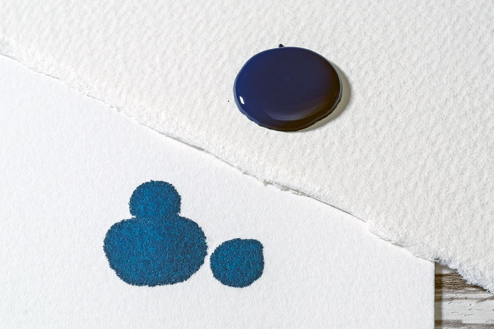 Blue Acrylic Ink on watercolour paper and blotting paper to demonstrate sizing and absorbence