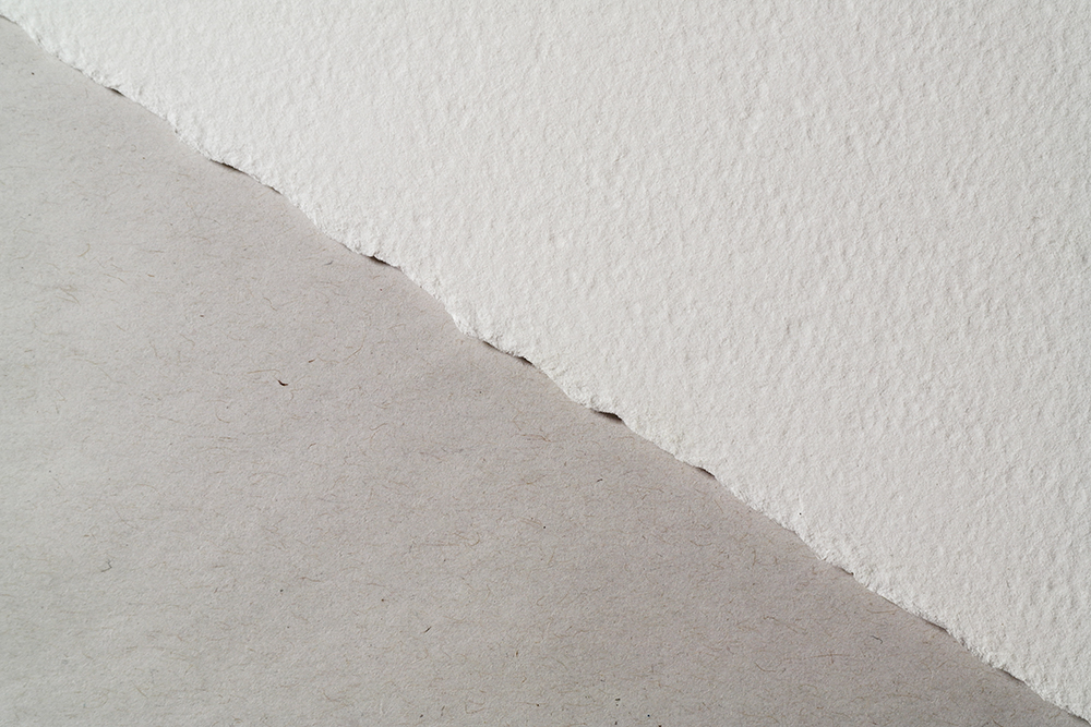 Archival 100% cotton watercolour paper and low cost, non archival newsprint paper compared side by side