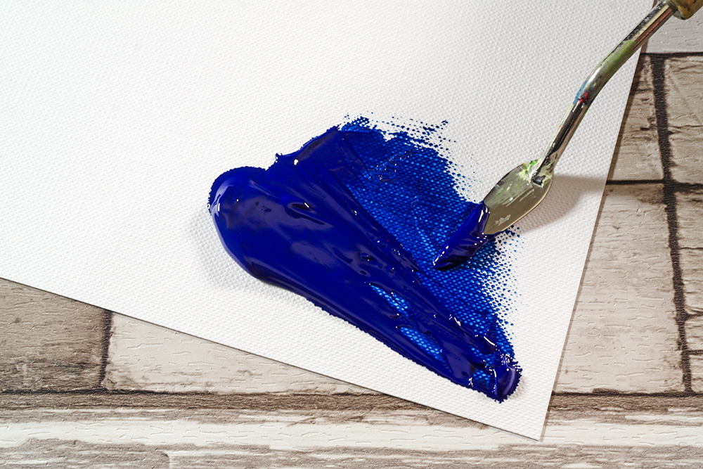 Blue Heavy Body Acrylic Paint applied to Fabriano Tela Paper with a palette knife