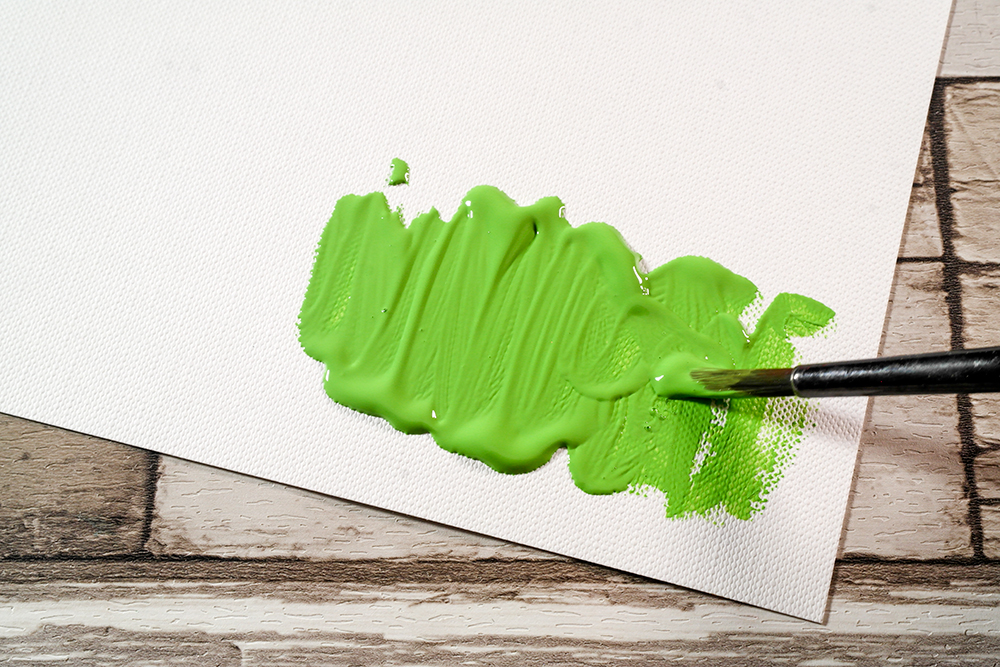 Green Soft Body Acrylic Paint applied to Fabriano Tela Paper with a brush