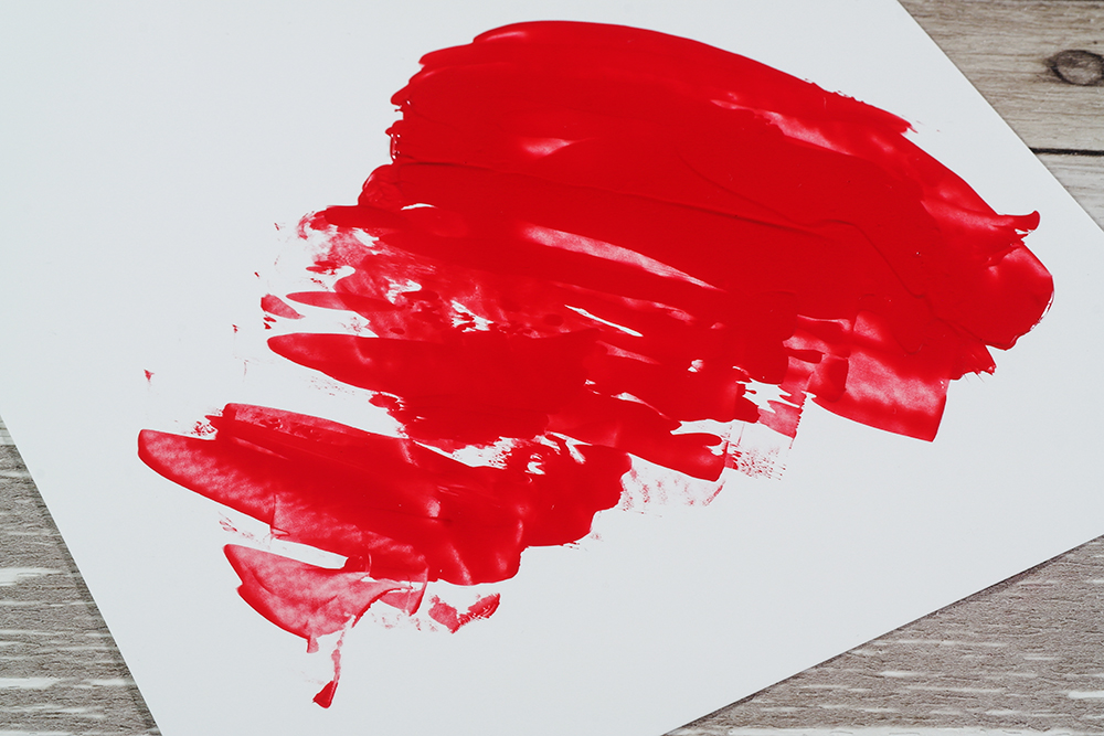 Red heavy body acrylic paint on YUPO paper