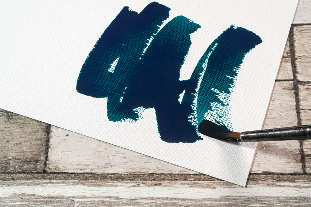 Turquoise Acrylic Ink applied to Fabriano Tela Paper with a brush