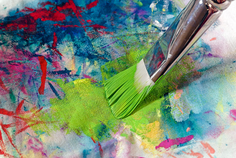 Step 2 - Blotting lime green acrylic paint from a large flat brush onto a paint rag
