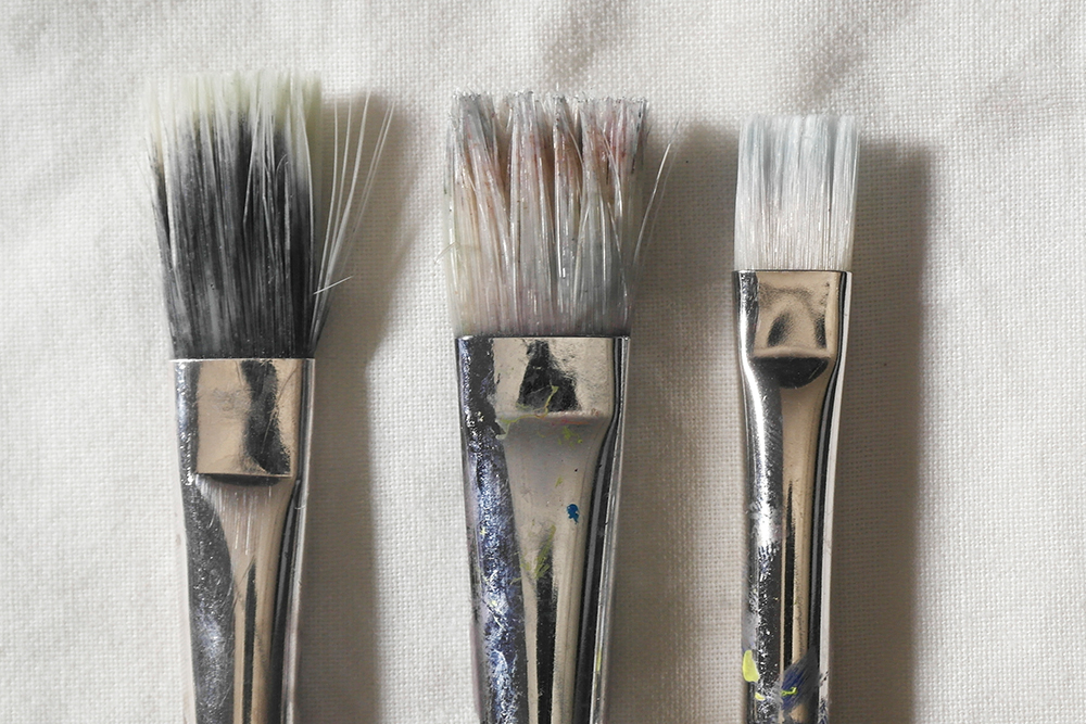 After - Three acfrylic paint brushes after intensive cleaning
